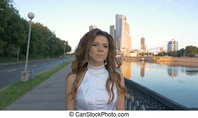 A beautiful girl with long hair in white clothes