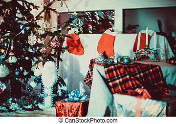A beautiful living room decorated for Xmas. Christmas family traditions.