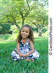 A beautiful mixed race child enjoying the outdoors