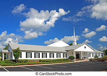 A beautiful modern church with a dynamic blue sky background