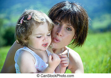 a beautiful mom is a hug to her daughter