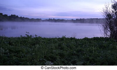 a beautiful, moving morning mist over the river