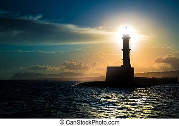 A beautiful night sky behind a shining lighthouse.