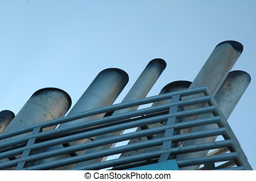 A beautiful picture of the pipes on the upper deck of the ship against the blue sky