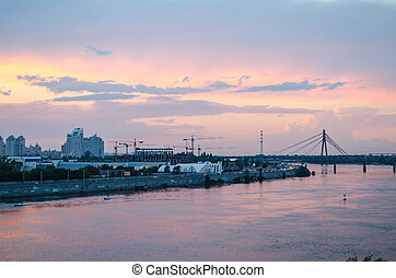A beautiful pink sunset over the city River. Industrial landscape.