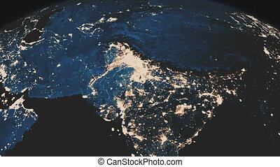 A beautiful realistic view of the planet Earth seen from outer space. Rotation of the Earth. Night sparkling cities