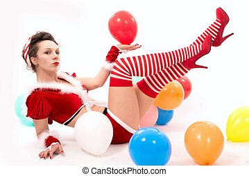 beautiful santa claus woman with colored ballons
