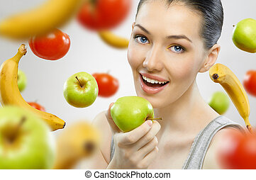 eating healthy fruit - A beautiful slender girl eating ...