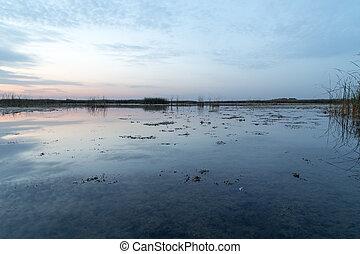 a beautiful sunset on the lake