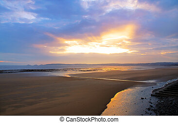 A beautiful sunset over Swansea beach and Mumbles, Wales