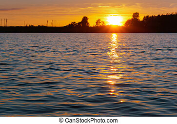 a beautiful sunset over the lake, sunset on the lake