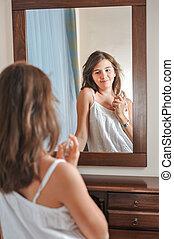 A beautiful teen girl in mirror
