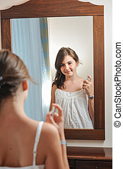 A beautiful teen girl in mirror