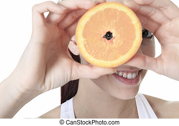 A beautiful training woman with fruit background
