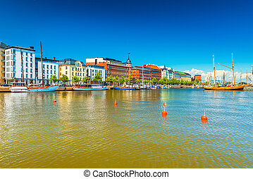 A beautiful view of Helsinki with historical buildings, harbor with boats and wooden old ship, Finland