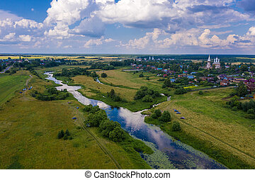 A beautiful view of the villages of Goritsy, Dunilovo and the Teza River, Ivanovo region on a summer day. Photo taken from a drone.