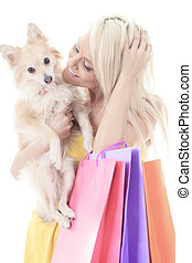 A Beautiful woman friends fashion, holding dog in studio gray ba
