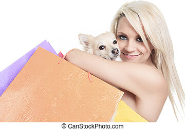 A Beautiful woman friends fashion, holding dog in studio gray ba