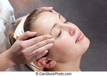 A beautiful woman getting a massage