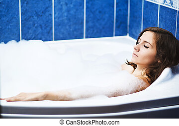 a beautiful woman in bathtub