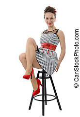 beautiful woman in retro style sitting on stool