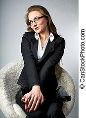 A beautiful woman wearing glasses