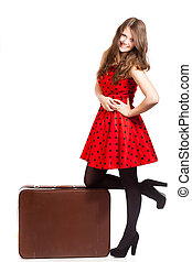 A beautiful woman with a luggage