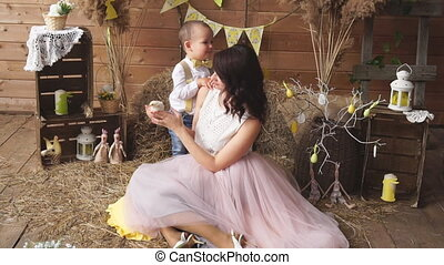 A beautiful woman with a son and a chick at a photo shoot