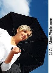 A beautiful woman with black umbrella