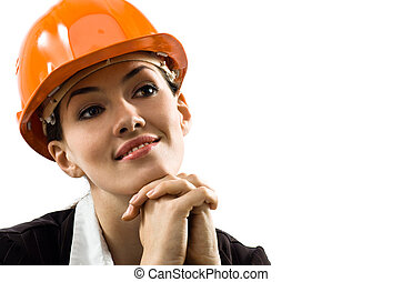 a beautiful young architector in a hardhat