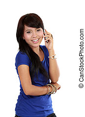 A beautiful young asian woman on the phone