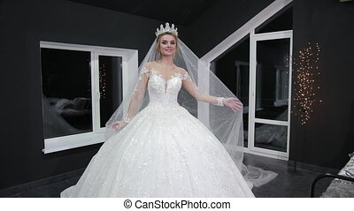 bride with crown on her head goes forward making minute on ...