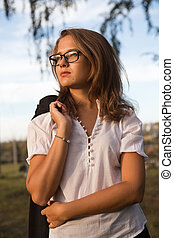 A beautiful young business woman walking outdoors