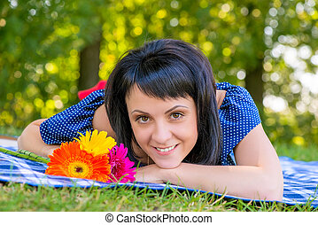 a beautiful young girl and a bouquet of flowers