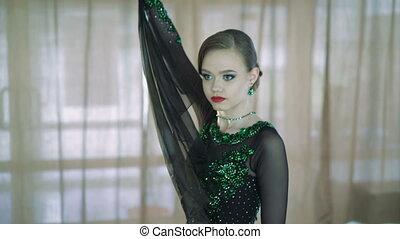 A beautiful young girl dancing ballroom dances. 4k