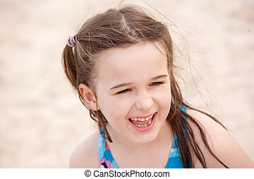 A beautiful young girl on the beach.