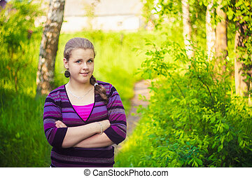A Beautiful Young Girl Standing On A Forest Path Road