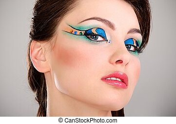 a beautiful young girl's face with makeup