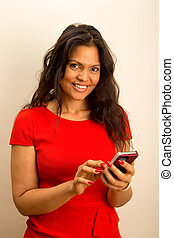 a beautiful young woman holding a mobile phone.