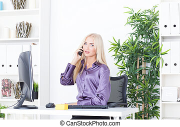 a beautiful young woman in an Office talking on the phone