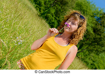 a beautiful young woman in nature