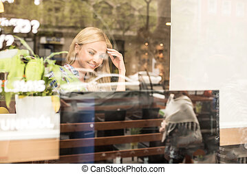 A beautiful young woman in the window