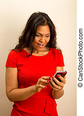 a beautiful young woman looking surprised at phone.