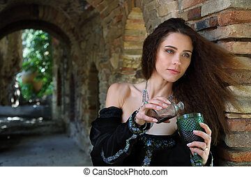 A beautiful young woman pours some poison into a glass