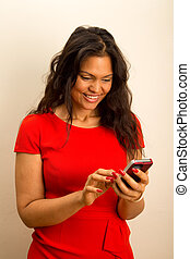 a beautiful young woman sending text messages.