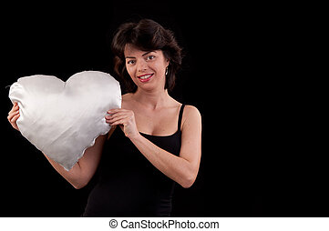 a beautiful young woman with a white heart in hand