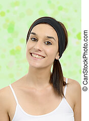 beautiful young woman with black headband in hair