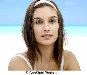 beautiful young woman with white headband in hair