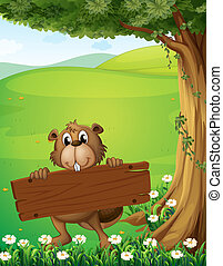 A beaver holding a wooden signboard near the tree