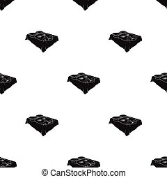 A bed with a black coverlet.Bed with a black cat on the blanket.Bed single icon in black style vector symbol stock illustration.